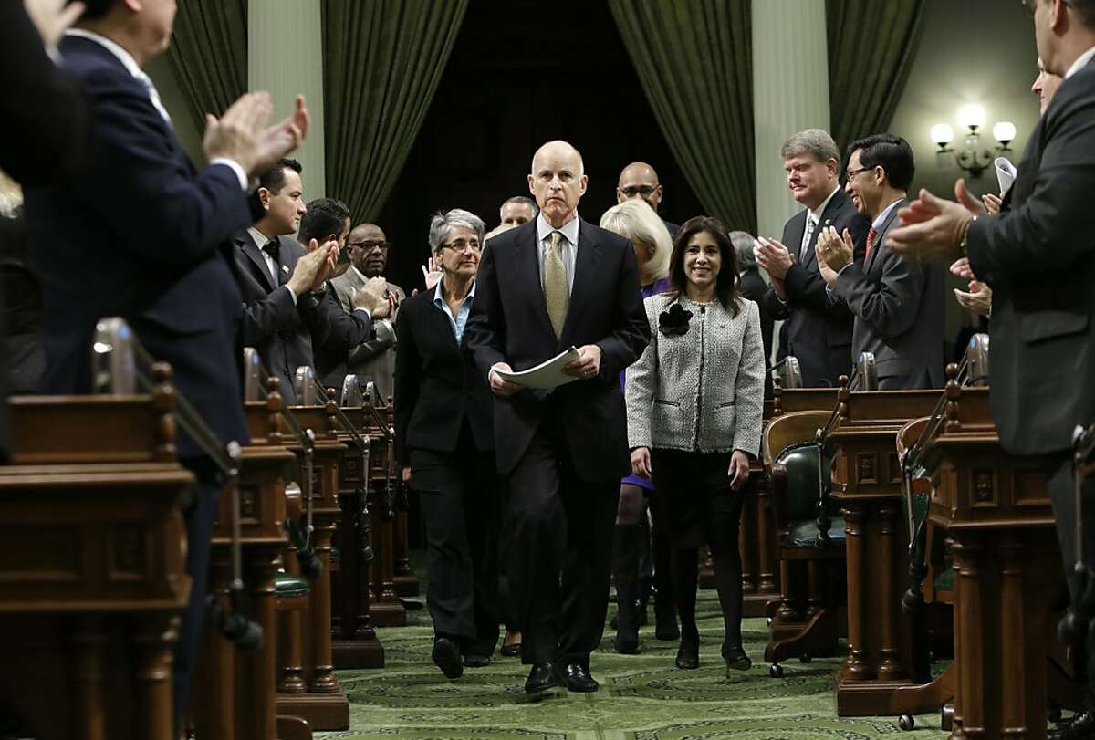 Lawmakers applaud Gov. Jerry Brown as he enters the Assembly Chambers to give his State of the State address at the Capitol in Sacramento, Calif., Thursday, Jan. 24, 2013. Brown delivered a State of the State address that laid out the legacy-building ideas he will work on during the second part of his term, including K-12 education reform, high-speed rail and the largest upgrade to the state't water-delivery system in decades. (AP Photo/Rich Pedroncelli)