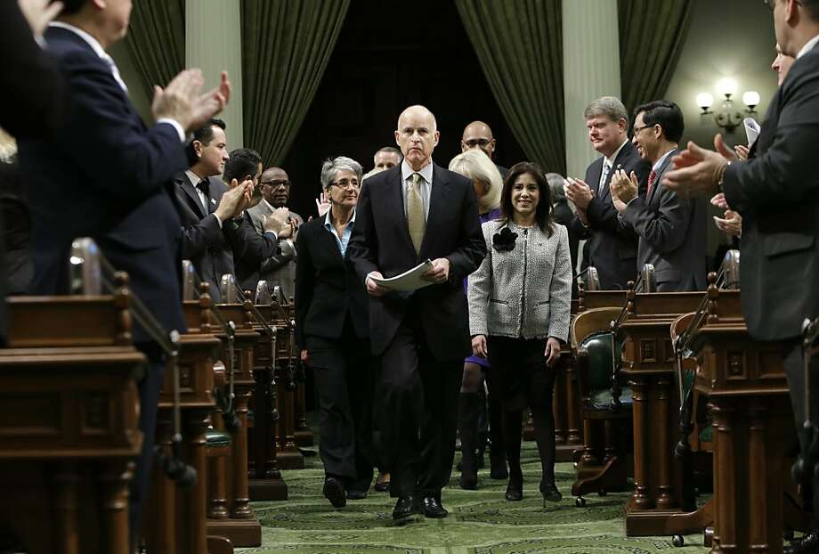 Lawmakers applaud Gov. Jerry Brown  as he enters the Assembly Chambers to give his State of the State address at the Capitol in Sacramento, Calif., Thursday, Jan. 24, 2013.   Brown delivered a State of the State address that laid out the legacy-building ideas he will work on during the second part of his term, including K-12 education reform, high-speed rail and the largest upgrade to the state't water-delivery system in decades. (AP Photo/Rich Pedroncelli) Photo: Rich Pedroncelli, Associated Press
