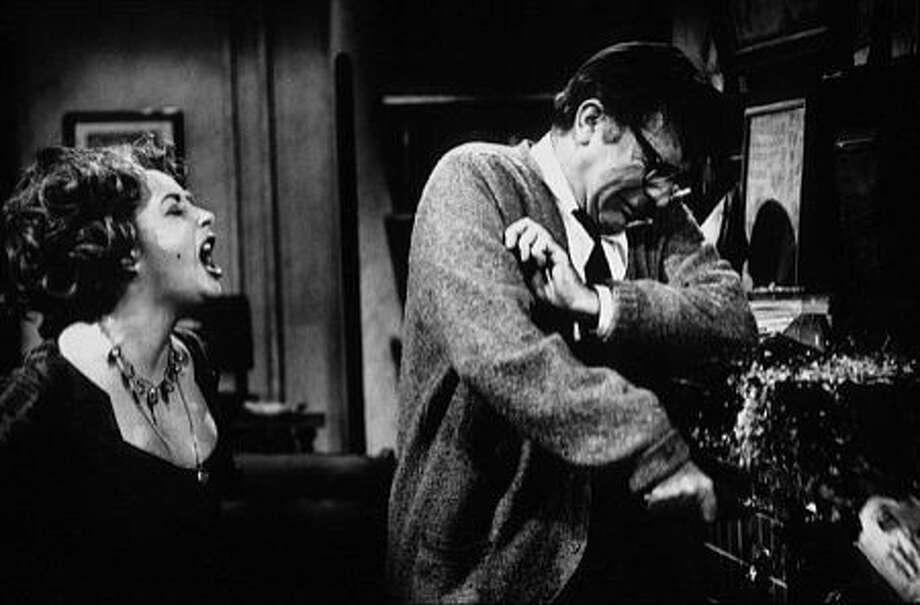 "Elizabeth Taylor and Richard Burton in ""Who's Afraid of Virginia Woolf"" 1966 Ran on: 04-08-2007 Elizabeth Taylor and Richard Burton in the 1966 film adaptation of &quo;Who's Afraid of Virginia Woolf?&quo; by Edward Albee, below in an undated photo. Photo: Warner Bros."