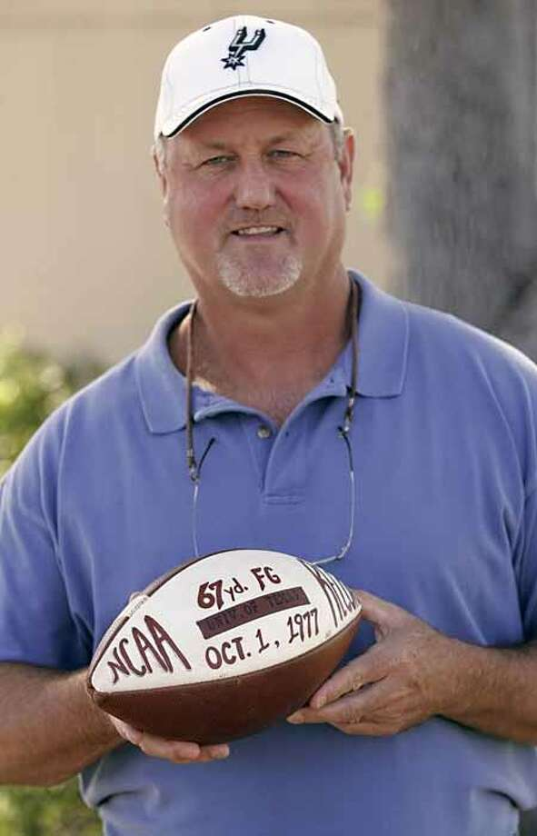Former University of Texas standout Russell Erxleben poses with the ball with which he kicked a record-setting 67-yard field goal. Photo: WILLIAM LUTHER, SAN ANTONIO EXPRESS-NEWS / SAN ANTONIO EXPRESS-NEWS