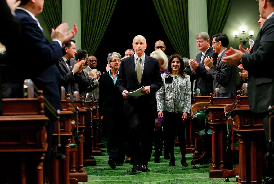 Lawmakers applaud Gov. Jerry Brown  as he enters the Assembly Chambers to give his State of the Stat