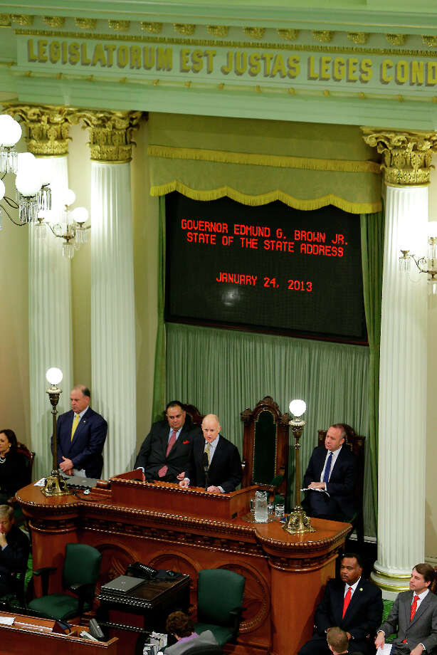 Flanked by Assembly Speaker John Perez, D-Los Angeles, left, and Senate President Pro Tem Darrell Steinberg, D-Sacramento, right, Gov. Jerry Brown gives his State of the State address at the Capitol in Sacramento, Calif., Thursday, Jan. 24, 2013.   Brown delivered a State of the State address that laid out the legacy-building ideas he will work on during the second part of his term, including K-12 education reform, high-speed rail and the largest upgrade to the state't water-delivery system in decades. Photo: Rich Pedroncelli, Associated Press / AP