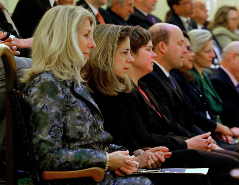 Anne Gust Brown, wife of Gov. Jerry Brown, second from left, listens to her husbands State of the St