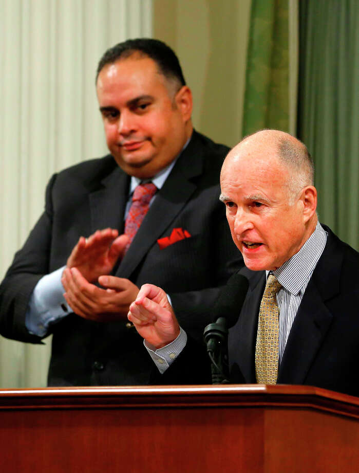Gov. Jerry Brown receives applause from Assembly Speaker John Perez, D-Los Angeles, left, as he gives his State of the State address at the Capitol in Sacramento. Photo: Rich Pedroncelli, Associated Press / AP