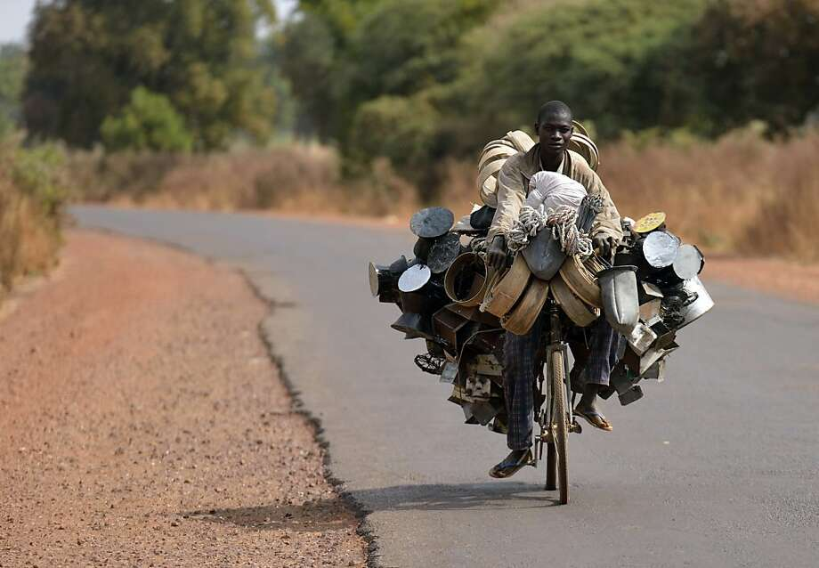 A pot peddler heads to market near Segou, Mali, with his entire inventory on two wheels. Photo: Eric Feferberg, AFP/Getty Images