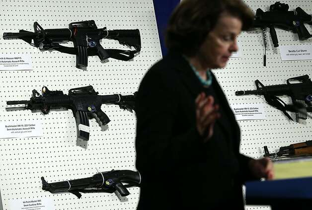 Sen. Dianne Feinstein (D-CA) speaks next to a display of assault weapons during a news conference January 24, 2013 on Capitol Hill in Washington, DC. Feinstein announced that she will introduce a bill to ban assault weapons and high-capacity magazines capable of holding more than 10 rounds to help to stop gun violence. Photo: Alex Wong, Getty Images
