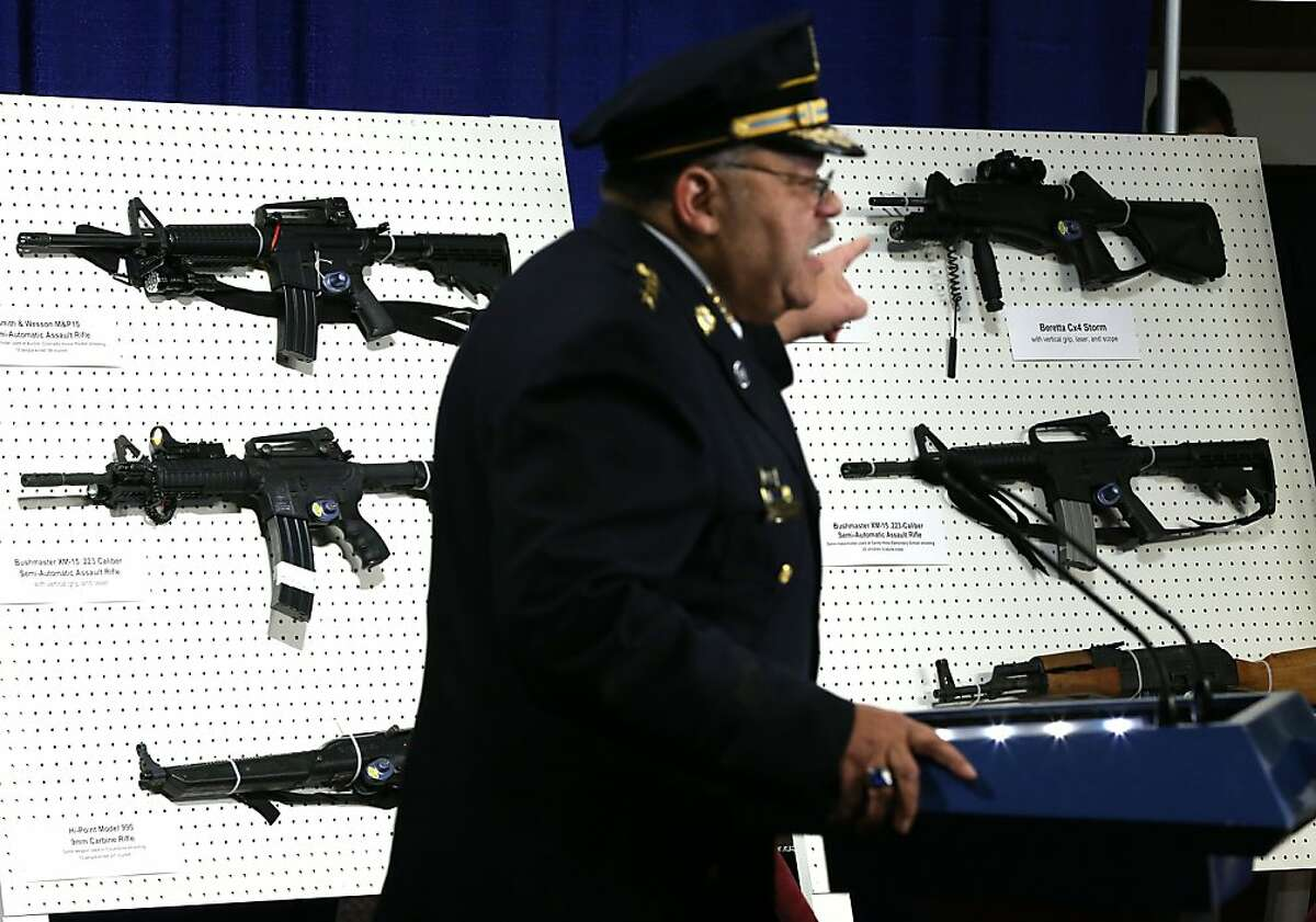 WASHINGTON, DC - JANUARY 24: Philadelphia Police Department Commissioner Charles Ramsey points to a display of assault weapons during a news conference January 24, 2013 on Capitol Hill in Washington, DC. U.S. Sen. Dianne Feinstein (D-CA) announced that she will introduce a bill to ban assault weapons and high-capacity magazines capable of holding more than 10 rounds to help to stop gun violence (Photo by Alex Wong/Getty Images)