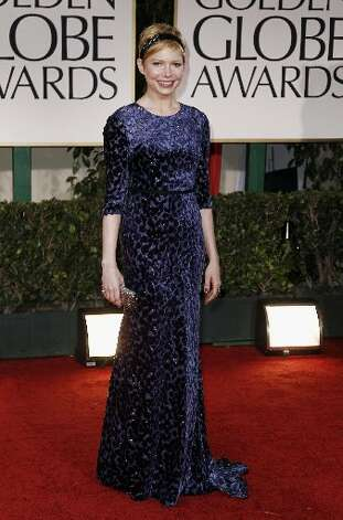 Michelle Williams arrives at the 69th Annual Golden Globe Awards Sunday, Jan. 15, 2012, wearing Jason Wu.