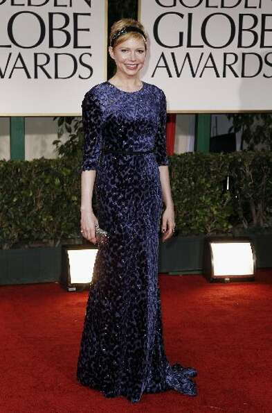 Michelle Williams arrives at the 69th Annual Golden Globe Awards Sunday, Jan. 15, 2012, wearing Jaso