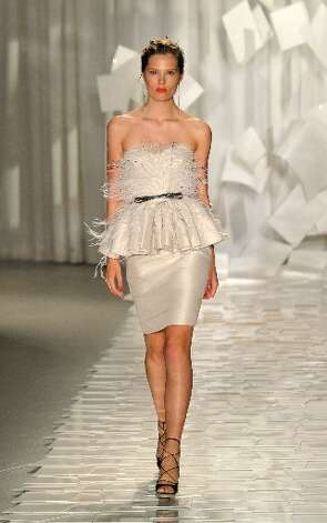 A waist-defining peplum top was also a spring 2012 signature.