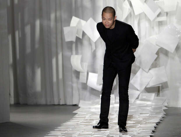 Designer Jason Wu takes a bow after presenting his Spring 2012 collection during Fashion Week in New York. Judges in his native Taiwan seem unimpressed that Wu has designed two inaugural gowns for U.S. first lady Michelle Obama. Taiwan's Intellectual Property Court ruled Monday, Jan. 21, 2013 that Wu's new label Miss Wu could not be registered as a brand because it was not distinctive enough. Photo: Mary Altaffer, Associated Press / AP