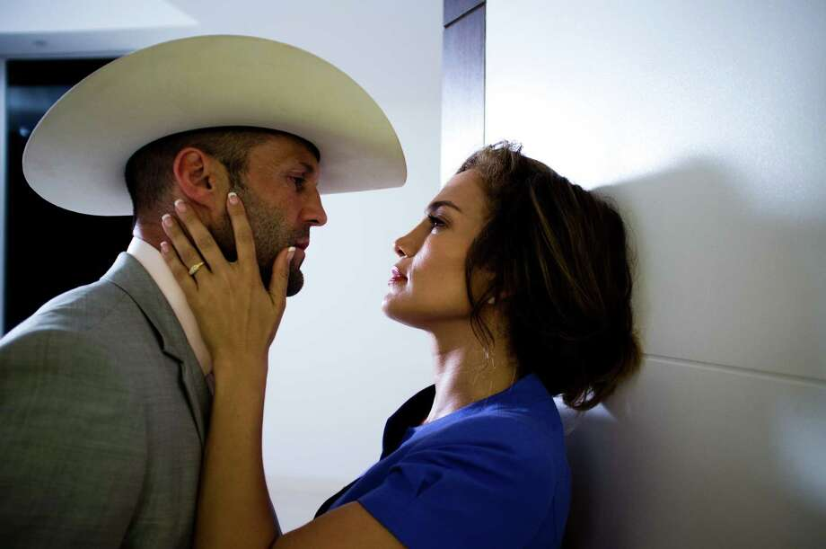 "Jack English/FilmDistrict Jason Statham stars as the title character in ""Parker."" With Jennifer Lopez. Photo: Jack English"