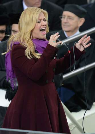 Singer Kelly Clarkson performs during the 57th Presidential Inauguration ceremonial swearing-in at the US Capitol on January 21, 2013 in Washington, DC.  AFP PHOTO / Saul LOEBSAUL LOEB/AFP/Getty Images Photo: SAUL LOEB / AFP