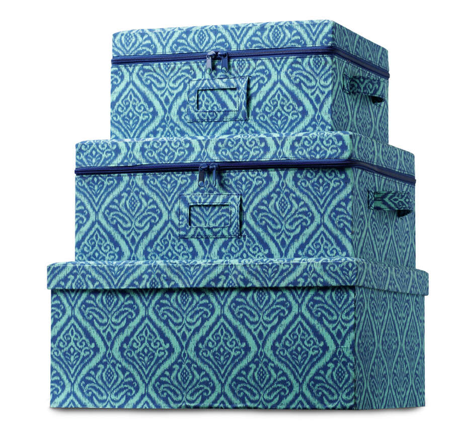 This undated publicity photo provided by HomeGoods shows a set of storage boxes in a deep blue print that add blue accents to a room in a practical way (www.homegoods.com). (AP Photo/HomeGoods)