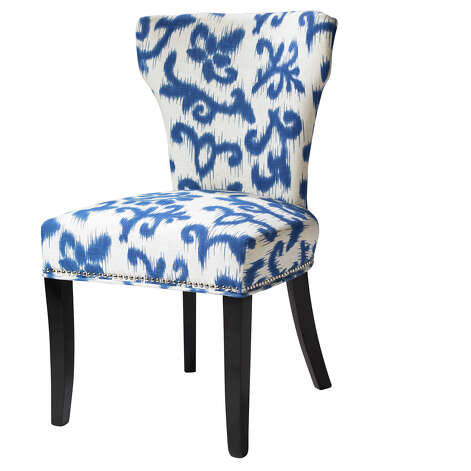 This undated publicity photo provided by HomeGoods shows an upholstered chair in a blue and white print from HomeGoods (www.homegoods.com). Blue and white prints are a big trend this spring. (AP Photo/HomeGoods)
