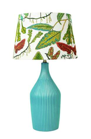 This undated publicity photo provided by Target shows a lamp from Target's Threshold spring decor line, in one of the season's statement colors – a rich blue (www.target.com).  Blues ranging from sky to teal to indigo are popping up in home decor retailers from now throughout the season. (AP Photo/Target)