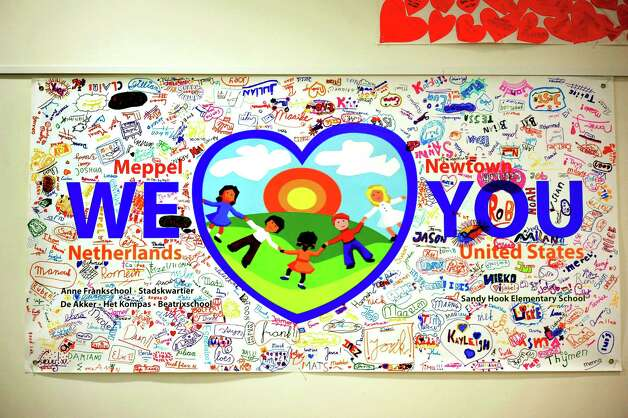 A banner of sympathy from children in the Netherlands is one of the contributions in the large gallery of condolences in Newtown Town Hall Thursday, Jan. 24, 2013. Photo: Michael Duffy / The News-Times