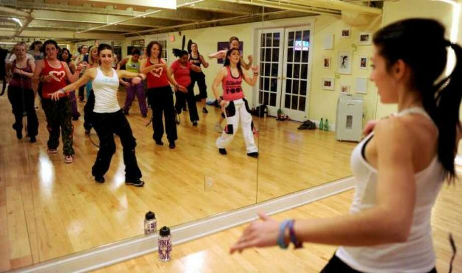 Nathalia Ferreira leads a zumba class at Momentum Fitness in Fairfield, February 23, 2011. Photo: Lindsay Niegelberg