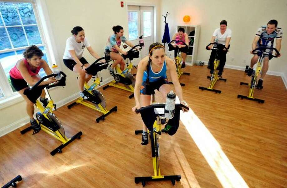 Natalie Staszak leads 6-Pack Cycle Class at Sun Angel Fitness in New Fairfield, Dec. 20, 2012. Photo: Michael Duffy