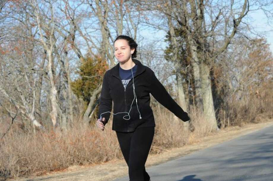 Madison Coppola, 18, of Greenwich, runs in the unseasonably warm weather at Greenwich Point, in Old Greenwich, Jan. 8, 2013. Photo: Helen Neafsey