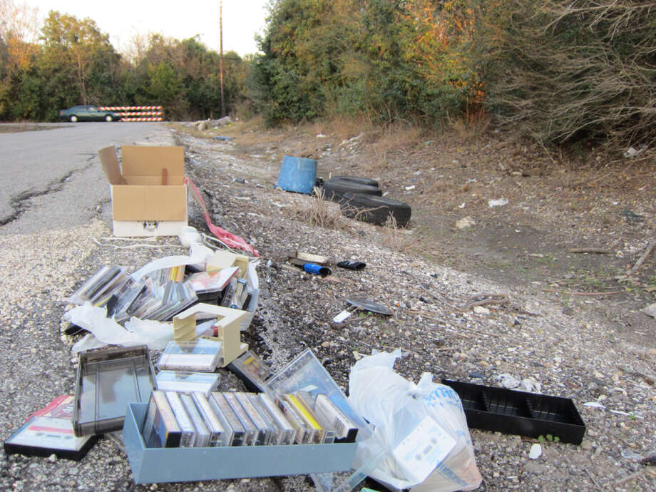 An illegal dump in the southwest of the city was the site of another of this first handful of camera-assisted prosecutions. Photo: Ingrid Lobet / Houston Chronicle