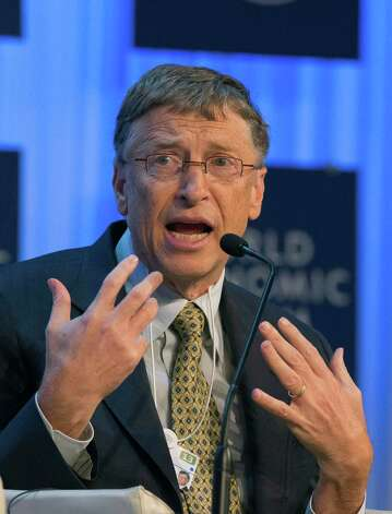Co-Chairman of the Bill & Melinda Gates Foundation, Bill Gates, gestures as he speaks to the assembly of the 43rd Annual Meeting of the World Economic Forum, WEF,  in Davos, Switzerland, Thursday, Jan. 24, 2013. (AP Photo/Michel Euler) Photo: Michel Euler, Associated Press / AP