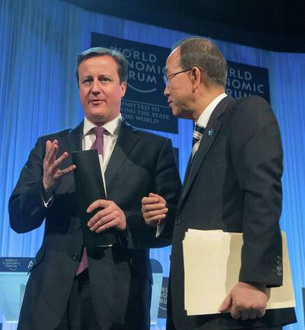 British Prime Minister, David Cameron, left, speaks with UN Secretary-General Ban Ki-moon,right, at the end of a session at the 43rd Annual Meeting of the World Economic Forum, WEF, while Queen Rania of Jordan sits next to him in Davos, Switzerland, Thursday, Jan. 24, 2013. (AP Photo/Michel Euler) Photo: Michel Euler, Associated Press / AP