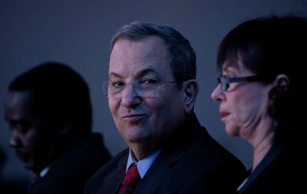 Israeli Minister of Defense Ehud Barak and his wife Nili Priel Barak attend a session of the World Economic Forum Annual Meeting 2013 on January 24, 2013 at the Swiss resort of Davos. The World Economic Forum (WEF) takes place from January 23 to 27. AFP PHOTO / JOHANNES EISELEJOHANNES EISELE/AFP/Getty Images Photo: JOHANNES EISELE, AFP/Getty Images / AFP