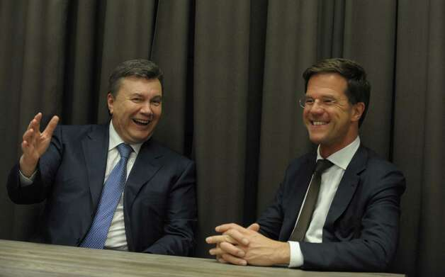 Ukrainian President, Viktor Yanukovych (L) talks with Dutch Prime Minister Mark Rutte (R) as Ukraine and the global oil giant Royal Dutch Shell signed on January 24, 2013 in Davos a $10 billion shale gas production sharing agreement aimed at helping the ex-Soviet nation ease its dependence on Russia. AFP PHOTO  ERIC PIERMONTERIC PIERMONT/AFP/Getty Images Photo: ERIC PIERMONT, AFP/Getty Images / AFP