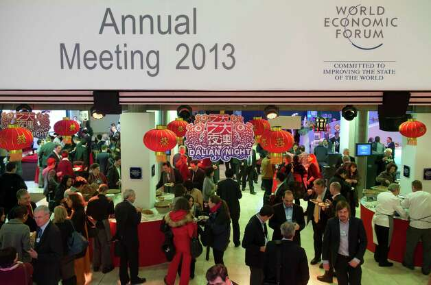 Participants attend a Dalian Reception at the 2013 World Economic Forum Annual Meeting on January 24, 2013 at the Swiss resort of Davos.  AFP PHOTO / JOHANNES EISELEJOHANNES EISELE/AFP/Getty Images Photo: JOHANNES EISELE, AFP/Getty Images / AFP