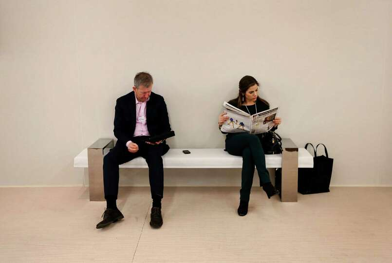 Delegates take a break during sessions on day two of the World Economic Forum (WEF) in Davos, Switze