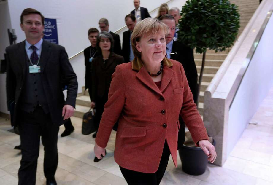 Angela Merkel, Germany's chancellor, arrives for a session on day two of the World Economic Forum (WEF) in Davos, Switzerland, on Thursday, Jan. 24, 2013. World leaders, influential executives, bankers and policy makers attend the 43rd annual meeting of the World Economic Forum in Davos, the five day event runs from Jan. 23-27. Photographer: Jason Alden/Bloomberg *** Local Caption *** Angela Merkel Photo: Jason Alden, Bloomberg / Copyright 2013 Bloomberg Finance LP, All Rights Reserved.