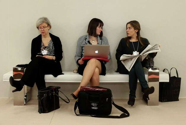 Female delegates take a break during sessions on day two of the World Economic Forum (WEF) in Davos, Switzerland, on Thursday, Jan. 24, 2013. World leaders, influential executives, bankers and policy makers attend the 43rd annual meeting of the World Economic Forum in Davos, the five day event runs from Jan. 23-27. Photographer: Jason Alden/Bloomberg Photo: Jason Alden, Bloomberg / Copyright 2013 Bloomberg Finance LP, All Rights Reserved.