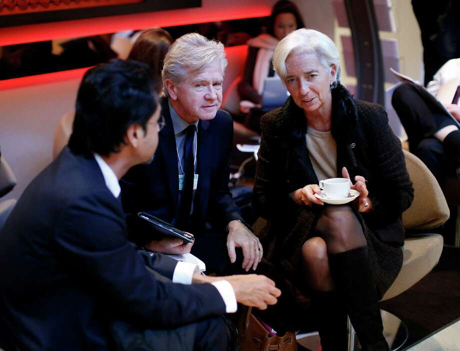 Christine Lagarde, managing director of the International Monetary Fund (IMF), right, takes a break with fellow delegates at the Congress Center cafe on day two of the World Economic Forum (WEF) in Davos, Switzerland, on Thursday, Jan. 24, 2013. World leaders, influential executives, bankers and policy makers attend the 43rd annual meeting of the World Economic Forum in Davos, the five day event runs from Jan. 23-27. Photographer: Jason Alden/Bloomberg *** Local Caption *** Christine Lagarde Photo: Jason Alden, Bloomberg / Copyright 2013 Bloomberg Finance LP, All Rights Reserved.