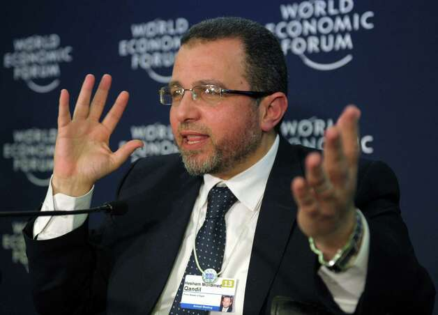 Egyptian Prime Minister Hisham Qandil talks during a press conference at the congress center during the World Economic Forum in Davos on January 24, 2013. The meeting gathers some of the world's leading politicians and economists and is viewed as a global think tank forum.    AFP PHOTO  ERIC PIERMONTERIC PIERMONT/AFP/Getty Images Photo: ERIC PIERMONT, AFP/Getty Images / AFP