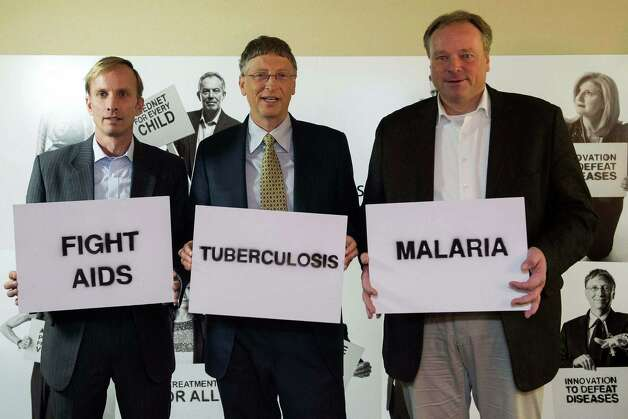 "Mark R. Dybul, Executive Director, The Global Fund to Fight AIDS, Tuberculosis and Malaria, left, William ""Bill"" Gates, Co-Chairman of the Bill & Melinda Gates Foundation, center, and Dirk Niebel, Federal Minister of Economic Cooperation and Development of Germany, right, pose during a photocall on the Global Fund to Fight AIDS, Tuberculosis and Malaria during the 43rd Annual Meeting of the World Economic Forum, WEF, in Davos, Switzerland, Thursday, Jan. 24, 2013.  (AP Photo/ Keystone/Jean-Christophe Bott) Photo: Jean-christophe Bott, Associated Press / KEYSTONE"
