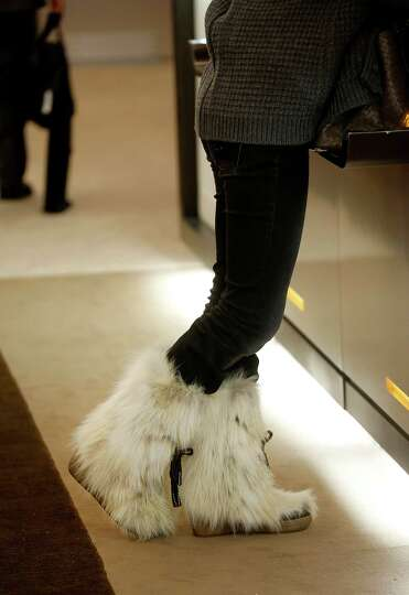 A female delegate wearing Apres-Ski boots arrives on day two of the World Economic Forum (WEF) in Da