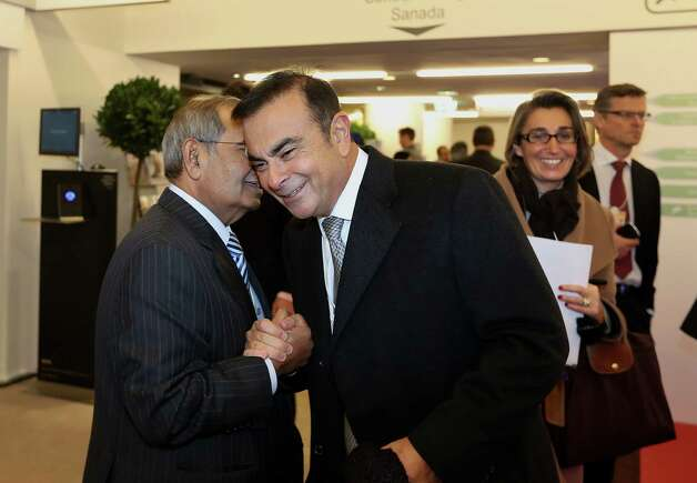 Carlos Ghosn, president and chief executive officer of Nissan Motor Co. Ltd., right, greets a fellow delegate on day two of the World Economic Forum (WEF) in Davos, Switzerland, on Thursday, Jan. 24, 2013. World leaders, influential executives, bankers and policy makers attend the 43rd annual meeting of the World Economic Forum in Davos, the five day event runs from Jan. 23-27. Photographer: Chris Ratcliffe/Bloomberg *** Local Caption *** Carlos Ghosn Photo: Chris Ratcliffe, Bloomberg / Copyright 2013 Bloomberg Finance LP, All Rights Reserved.