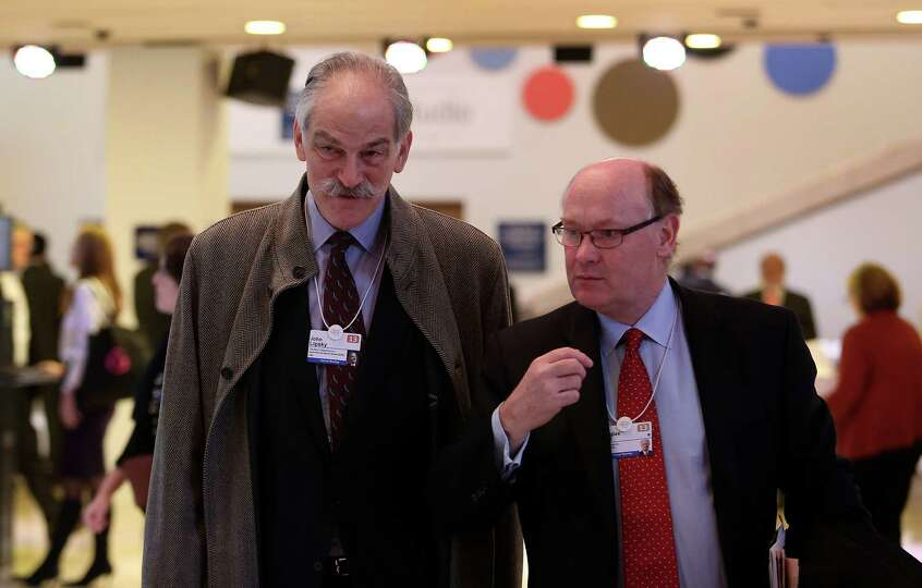 Douglas Flint, chairman of HSBC Holdings Plc, right, arrives with John Lipsky, former special adviso