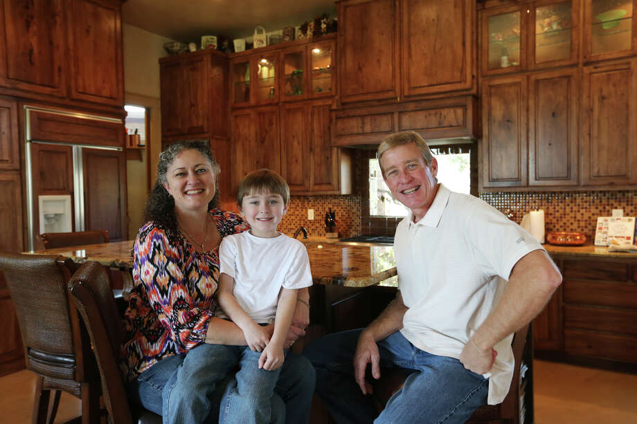 The Guest family sit it their kitchen at their home northeast of New Braunfels, Sunday, Jan. 20, 2013. They are from left, Gail, Reagan, 5, and Ryan Guest. Photo: Jerry Lara, San Antonio Express-News / © 2013 San Antonio Express-News