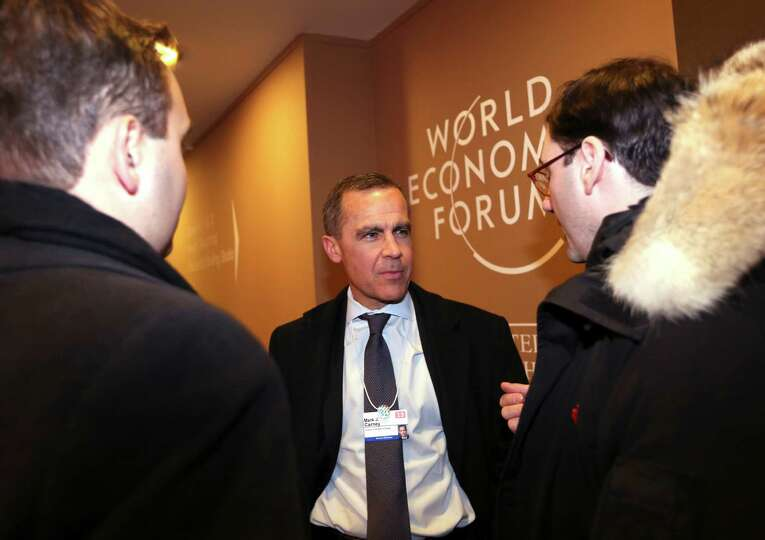 Mark Carney, governor of the central bank of Canada, center, speaks to an attendee on day two of the