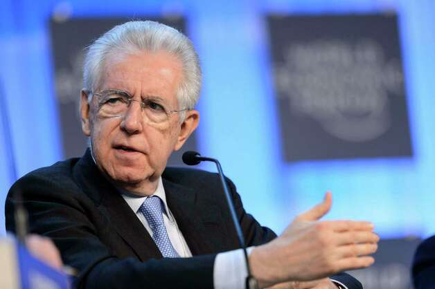 Italian Prime Minister Mario Monti speaks during a panel session of the 43rd Annual Meeting of the World Economic Forum, WEF, in Davos, Switzerland, Thursday, Jan. 24, 2013. (AP Photo/Keystone/Laurent Gillieron) Photo: Laurent Gillieron, Associated Press / KEYSTONE