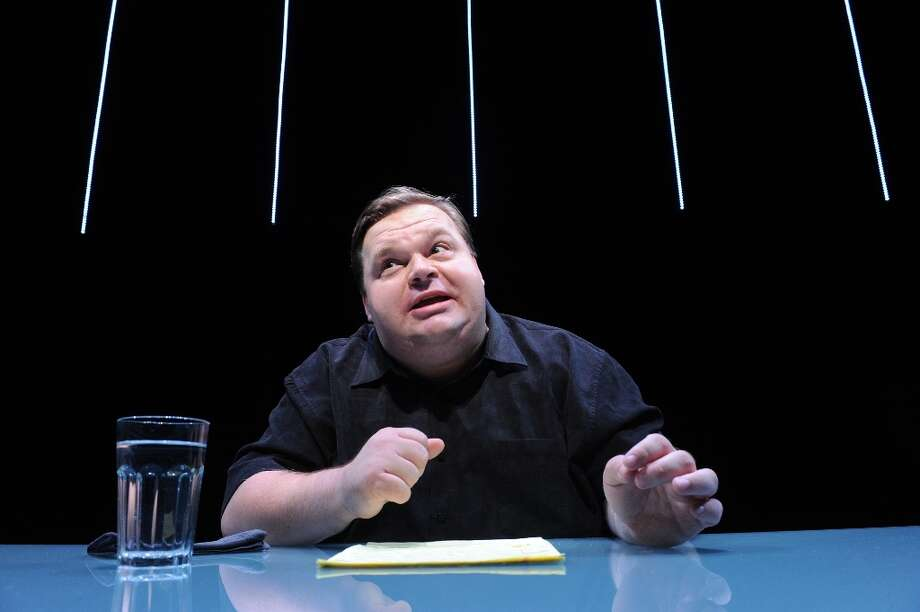 "In this undated image released by The Public Theater, Mike Daisey is shown in a scene from The Agony and The Ecstasy of Steve Jobs, in New York. Daisey, whose latest show has been being credited with sparking probes into how Apple's high-tech devices are made, found himself under fire for distorting the truth. The public radio show ""This American Life"" retracted a story Friday, March 16, 2012, that it broadcast in January about what Daisey said he saw while visiting a factory in China where iPads and iPhones are made. Photo: Stan Barouh, Associated Press / AP2011"