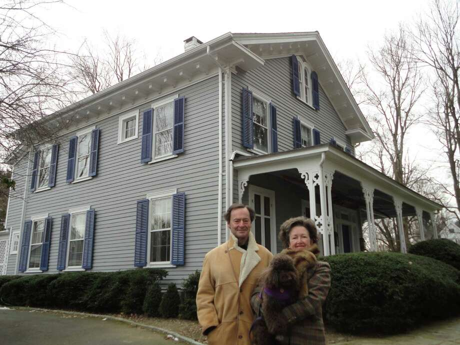 Jarvis and Coke Anne Wilcox and their dog Cocoa pose in front of the historic house at 25 Turkey Hill Road South, which they want to covert into a bed and breakfast. WESTPORT NEWS, CT 1/21/13 Photo: Meg Barone / Westport News freelance