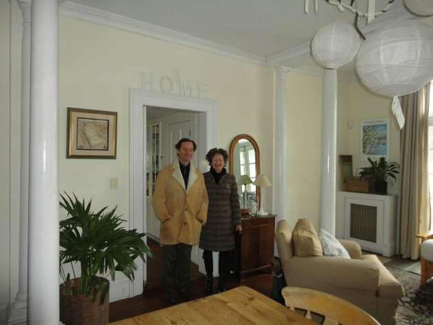 Jarvis and Coke Anne Wilcox pose in the dining room of their house at 25 Turkey Hill Road South. This is the room where guests would congregate for breakfast if their proposal to convert the house from its current rental home status to a bed and breakfast wins approval. WESTPORT NEWS, CT 1/21/13 Photo: Meg Barone / Westport News freelance
