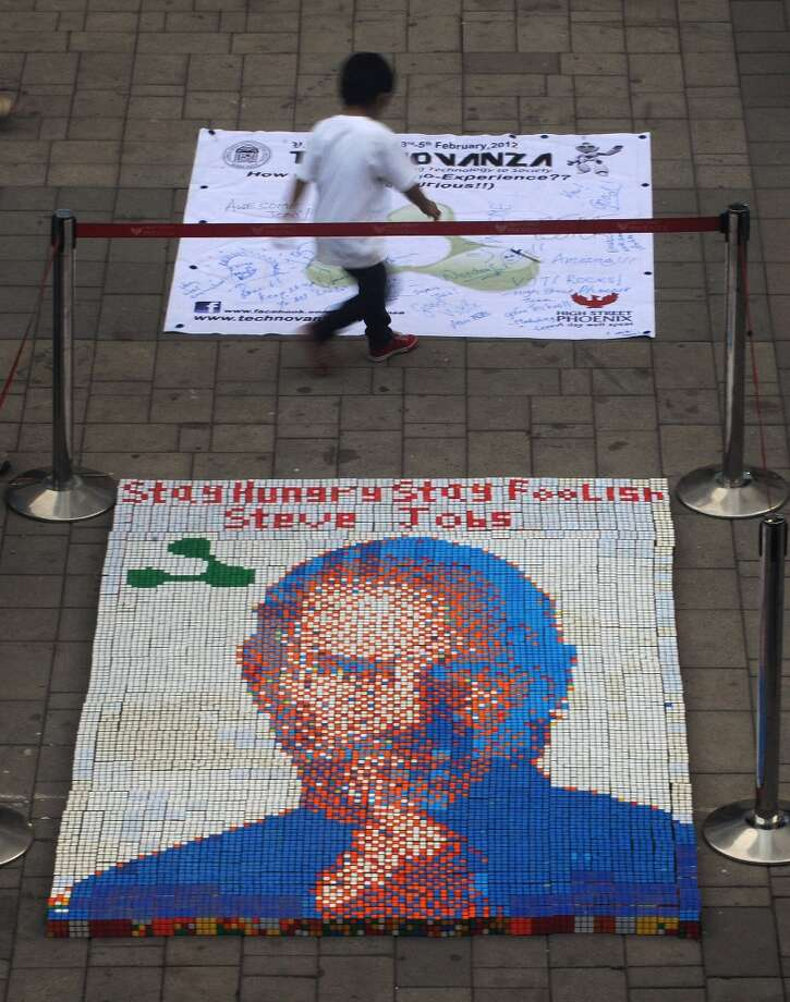 A portrait of late Apple co-founder Steve Jobs, made from some 1,500 Rubik's cubes, is seen on display at the High Street Phoenix Mall in Mumbai on January 13, 2012. Students from India's Veermata Jijabai Technological Institute (VJTI) displayed the portrait as part of their 'Technovanza 2012' show. Photo: PUNIT PARANJPE, AFP/Getty Images / AFP
