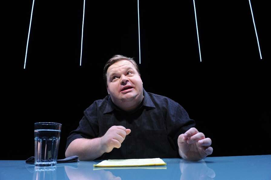 In this undated image released by The Public Theater, Mike Daisey is shown in a scene from The Agony