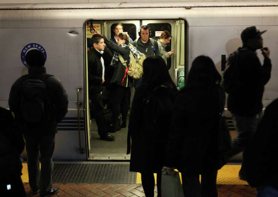Commuters wait for trains in the Montgomery BART Station in January 2013. Photo: Pete Kiehart / The Chronicle / ONLINE_YES