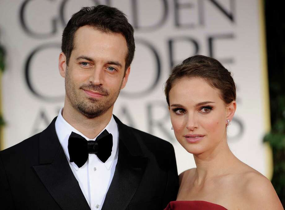 "FILE - In this Sunday Jan. 15, 2012 file photo, Benjamin Millepied, left, and Natalie Portman arrive at the 69th Annual Golden Globe Awards in Los Angeles. Benjamin Millepied, the ""Black Swan"" choreographer who helped transform Natalie Portman into an obsessed, paranoid ballerina for the film and later married the actress, was named director of the Paris Opera Ballet, Thursday, Jan. 24, 2013. (AP Photo/Chris Pizzello, File) Photo: Chris Pizzello"