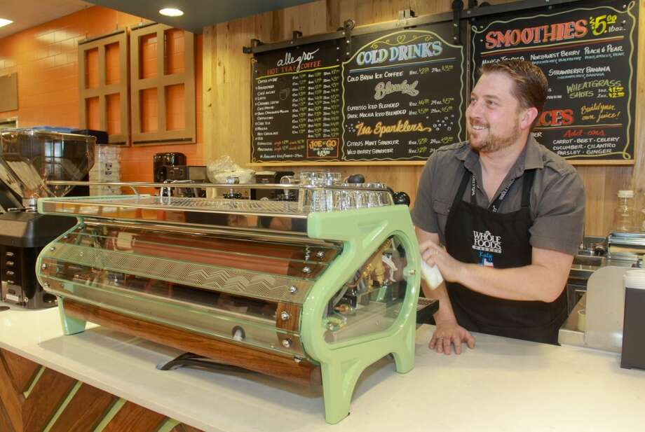 Matt McCarty setting up a La Marzocco Strada MP espresso machine in the Allegro Coffee Bar in the new Whole Foods Market in Katy, Jan. 24, 2013.